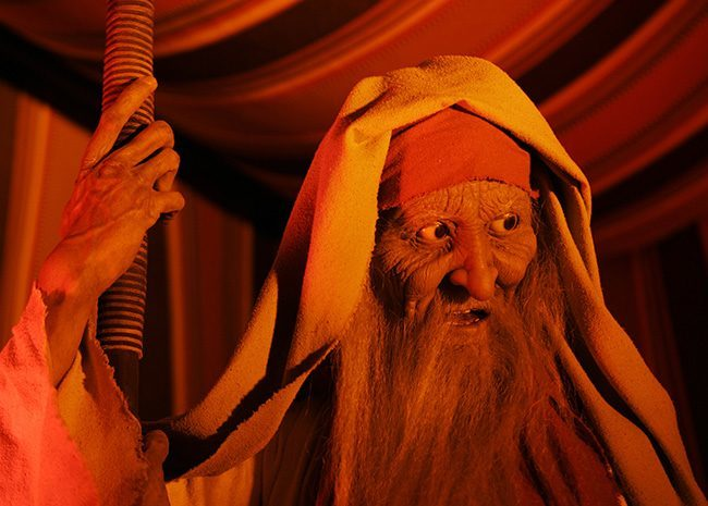 Bathed in a brilliant yellow light, an animatronic likeness of Methuselah talks to visitors during a tour of the new Creation Museum in Petersburg, Ky., Thursday, May 24, 2007. (AP Photo/Ed Reinke)