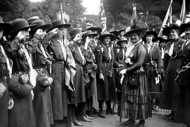 Lady Baden Powell inspects the guard of honour of Girl Guides at Battersea Park.