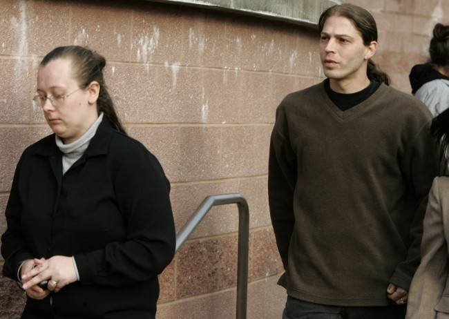 In this March 12, 2009 file photograph, Heath Campbell, right, and his wife, Deborah, leave the Hunterdon County Justice Center in Flemington, N.J., after a court hearing to determine custody of their three children with Nazi-inspired names. On Thursday, Aug. 5, 2010, a state appeals court determined the Campbells should not regain custody of their children, after the New Jersey Division of Youth Family Services removed the Campbell's three children, Adolph Hitler Campbell, 3, and younger sisters JoyceLynne Aryan Nation Campbell and Honszlynn Jeannie Campbell, from their home in Holland Township, N.J., on Jan. 9, 2009, for unspecified reasons. (AP Photo/Mike Derer, File)