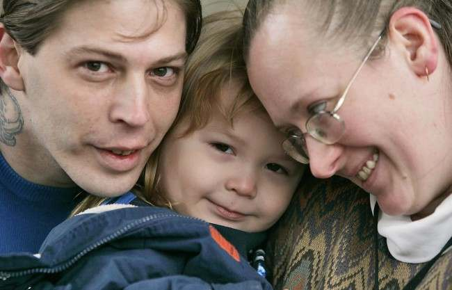 In this Tuesday, Dec. 16, 2008 file photo, Heath Campbell, left, with his wife, Deborah, and son Adolf Hitler Campbell, 3, pose in Easton, Pa. On Thursday, Aug. 5, 2010, a state appeals court determined the Campbells should not regain custody of their children, after the New Jersey Division of Youth Family Services removed the Campbells three children, Adolph Hitler Campbell, 3, and younger sisters JoyceLynne Aryan Nation Campbell and Honszlynn Jeannie Campbell, from their home in Holland Township, N.J., on Jan. 9, 2009, for unspecified reasons. (AP Photo/Rich Schultz, File)