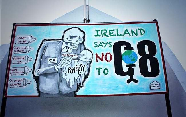 free derry G8 protestors erect this huge mural at Free Derry Corner