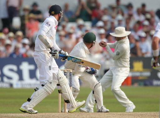 England batsman Stuart Broad is caught by Australia captain Michael Clarke but its not given by umpire Aleem Dar, during day three of the First Investec Ashes Test match at Trent Bridge, Nottingham.