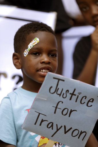 "Jonathan Money, 4, holds a sign at a ""Justice for Trayvon"" rally in New Orleans, Saturday, July 20, 2013. The Rev. Al Sharpton's National Action Network organized ""Justice for Trayvon"" rallies nationwide to press for federal civil rights charges against George Zimmerman, who was found not guilty in the shooting death of unarmed teenager Trayvon Martin. (AP Photo/Gerald Herbert)"