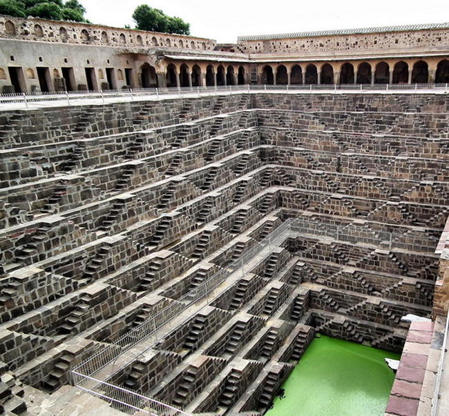 Chand Baori is a famous stepwell situated in the village of Abhaneri near Jaipur in the Indian state of Rajasthan.It was constructed in 800 CE. Its 3500 narrow steps in 13 stories extend 100 feet (30 m) into the ground, making it one of the deepest (and largest) stepwells in India.