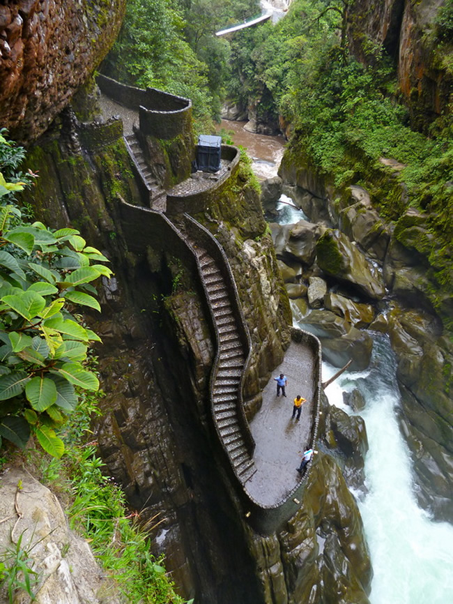 This famous Canyon Staircase is located next to the waterfall Pailon del Diablo in Ecuador. The Paílón del Diablo is a fairly large waterfall (located on the Pastaza River) just 30 minutes away from the town of Baños in Ecuador. It is considered to be one of the most popular attractions in the area. While visiting Ecuador one should not miss this wonderful twisting stairs/steps. [link, map]