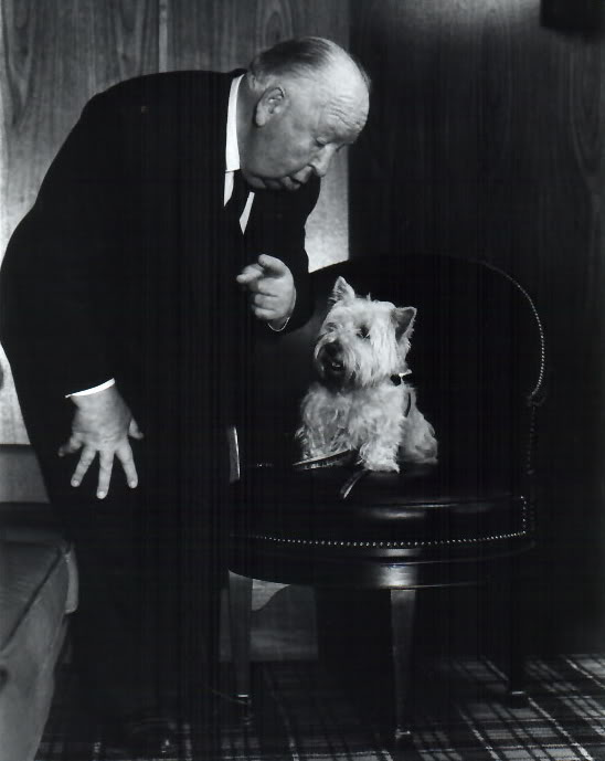 Alfred Hitchcock gives direction to his terrier Sarah.