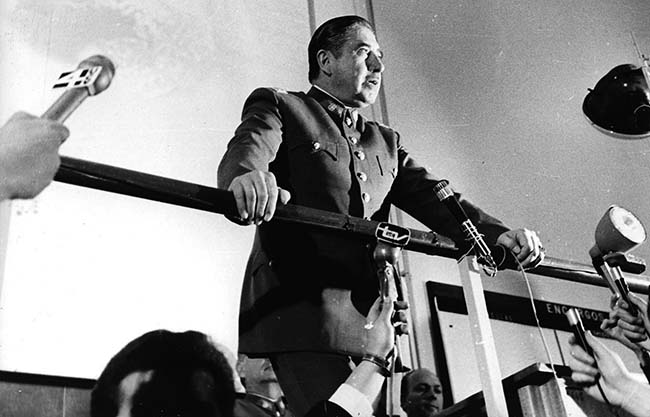"n this 1974 file photo, Chilean dictator Gen. Augusto Pinochet speaks at an informal press conference in Santiago, Chile. Newly declassified U.S. documents indicate that Pinochet planned to use violence to annul the referendum that ended his brutal regime in 1988. The formerly secret documents posted by the independent U.S. National Security Archive on Friday, Feb. 22, 2013 showed U.S. officials warning Chilean leaders against violence if Pinochet tried to use force to stay in power if people voted against eight more years of his rule. They also show U.S. officials and agencies backed the anti-Pinochet campaign portrayed in the Oscar-nominated film ""No,"" even though the U.S. government also had tried to undermine the socialist government Pinochet had overthrown. (AP Photo, File)"