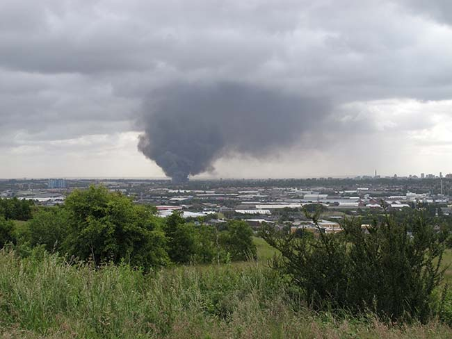 A view from the Tividale area of the West Midlands, of rising smoke from a fire at J&A Young in Smethwick, Birmingham, as more than 200 firefighters tackle a blaze at the plastics recycling plant.