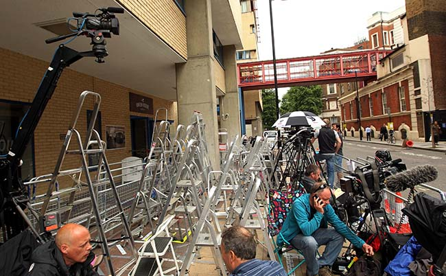 A collection of ladders stand outside the Lindo Wing of St Mary's Hospital in Paddington, London as members of the media reserve a place outside where the Duchess of Cambridge will give birth later this month.