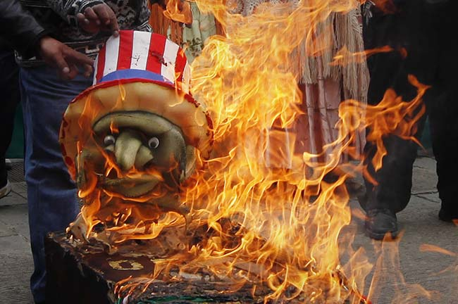Demonstrators burn a coffin and a replica of Uncle Sam outside the U.S. embassy in La Paz, Bolivia, Monday, July 8, 2013. Bolivia's President Evo Morales has accused the United States of pressuring European governments to deny his plane permission to enter their airspace amid suspicions that NSA leaker Edward Snowden might have been onboard. Venezuela and Bolivia both made asylum offers to Snowden over the weekend, and Nicaragua has said it is also considering his request. (AP Photo/Juan Karita)