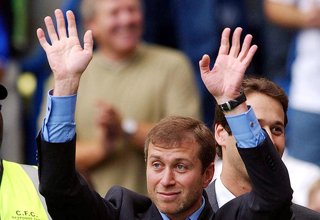 Chelsea's owner Roman Abramovich greets the home supporters before their FA Premiership match against Leicester City at Chelsea's Stamford Bridge ground in London.  30/01/04: The Russian billionaire owner of Chelsea soccer club, will face checks by Russia's highest auditing body starting next month, its chief said in Moscow today.  07/03/04: Roman Abramovich is the UK's richest person with a family fortune almost seven times that of the Queen, according to a new report. The Russian's   7.2 billion wealth puts him top of the Mail on Sunday Rich Report 2004, ahead of Tetrapak billionaire Hans Rausing and the Duke of Westminster. The report includes the 300 richest UK-based men and women whose combined wealth comes to  147.3 billion - up 28% on a year ago. The Rich Report magazine team spent two months researching the Abramovich assets. THIS PICTURE CAN ONLY BE USED WITHIN THE CONTEXT OF AN EDITORIAL FEATURE. NO WEBSITE/INTERNET USE UNLESS SITE IS REGISTERED WITH FOOTBALL ASSOCIATION PREMIER LEAGUE.
