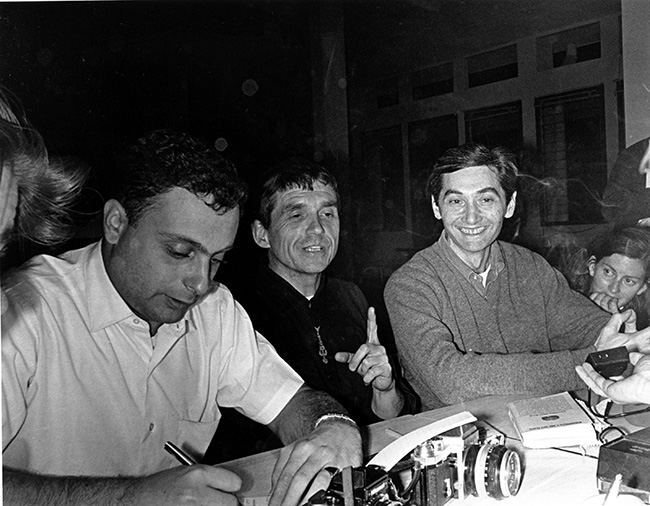 This is an April 1970 photo of the Rev. Daniel Berrigan, center, who was convicted for burning Selective Service records to protest the Vietnam War. (AP Photo)