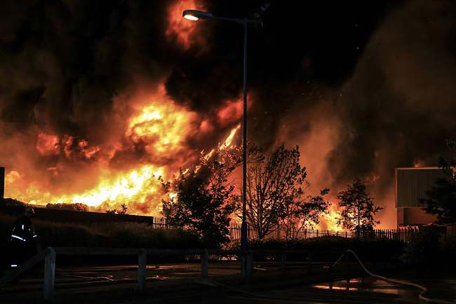 Firefighters during a fire at J&A Young in Smethwick, Birmingham, as more than 200 firefighters tackle a blaze at the plastics recycling plant.