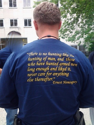 An anonymous public defender sent Gothamist this photo of an NYPD warrant squad officer wearing a t-shirt with a pretty quote from Ernest Hemingway: