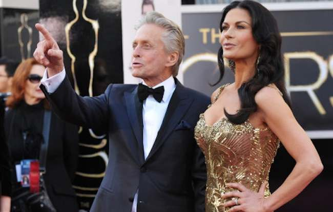 Actors Michael Douglas, left, and Catherine Zeta-Jones arrive at the Oscars at the Dolby Theatre on Sunday Feb. 24, 2013, in Los Angeles. (Photo by John Shearer/Invision/AP)