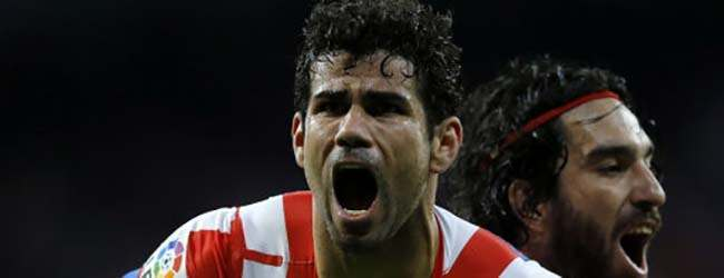 Atletico de Madrid Diego Costa from Brazil celebrates after scoring against Real Madrid during the Copa del Rey final soccer match at the Santiago Bernabeu stadium in Madrid, Spain, Friday, May 17, 2013. (AP Photo/Daniel Ochoa de Olza)