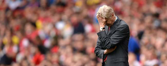 **Alternative Crop** Arsenal manager Arsene Wenger looks dejected on the touchline