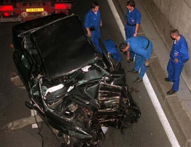 Police services prepare to take away the car in which Diana, Princess of Wales, died in a car crash that also killed her boyfriend, Dodi Fayed, and the chauffeur. The crash happened shortly after midnight in a tunnel along the Seine River at the Pont de l Alma bridge, while paparazzi on motorcycles were following her car.