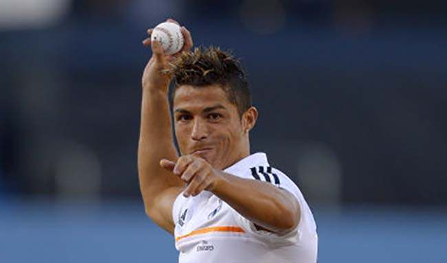 Real Madrid soccer player Cristiano Ronaldo, of Portugal, throws out the ceremonial first pitch prior to the Los Angeles Dodgers' baseball game against the New York Yankees, Wednesday, July 31, 2013, in Los Angeles. (AP Photo/Mark J. Terrill)