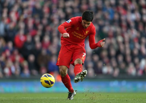 Liverpool's Luis Suarez scores his side's fourth goal of the game