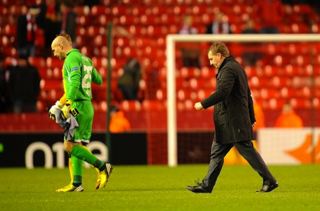 Liverpool's Jose Reina (left) and manager Brendan Rodgers walk off dejected after the final whistle