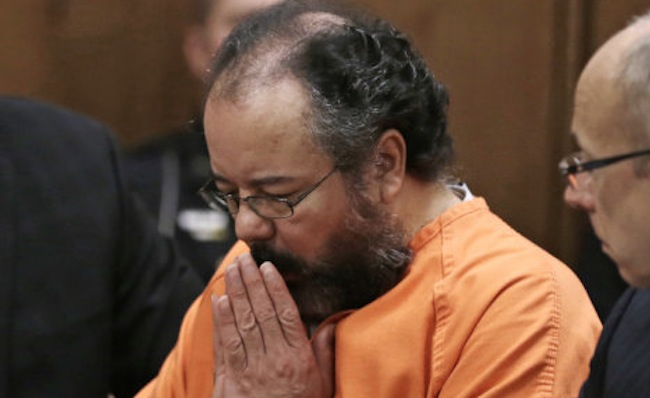 Ariel Castro sits in the courtroom during the sentencing phase Thursday, Aug. 1, 2013, in Cleveland.  Castro, convicted of holding three women captive in a house he turned into a prison and raping them repeatedly for a decade, was sentenced Thursday to life without parole plus 1,000 years. (AP Photo/Tony Dejak)