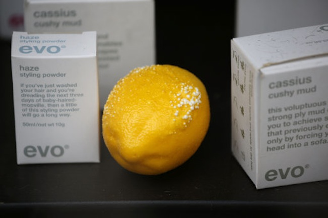 "A lemon, with blistering from the sun, is seen in the window of a gentlemen's grooming shop across the street from the 37-storey skyscraper at 20 Fenchurch Street in the City of London, which is still under construction, Tuesday, Sept. 3, 2013. Developers for an unfinished skyscraper in central London say they are investigating the way the building reflects bright sunlight _ after claims that the intense glare melted parts of a car parked nearby. The companies behind the skyscraper, nicknamed the ""Walkie-Talkie"" because of its curved shape, are responding to complaints from the owner of a Jaguar who told the BBC that the mirror, panels and the Jaguar badge had all melted from the concentrated heat of sunlight reflected from the building. (AP Photo/Matt Dunham)"