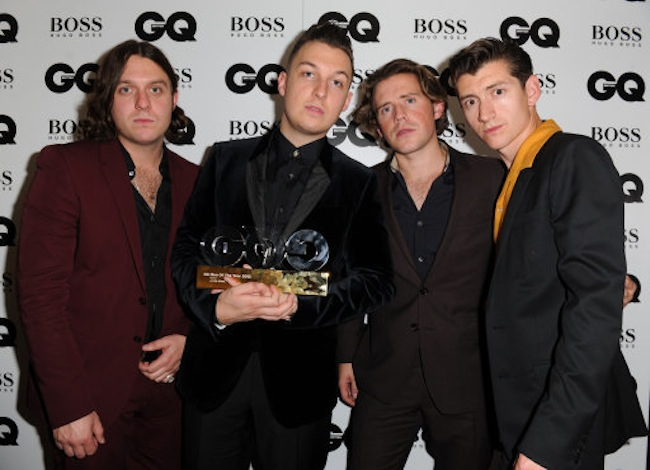 The Arctic Monkeys, winner of the Band award, pose backstage at the GQ Men of the Year Awards in association with Hugo Boss at the Royal Opera House, London.