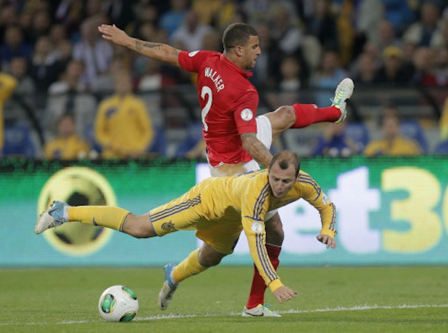 Roman Zozulya of Ukraine, front, vies for the ball with Kyle Walker of England during the World Cup group H qualifier soccer match between Ukraine and England at the Olympiyskiy national stadium in Kiev, Ukraine, Tuesday, Sept. 10, 2013. (AP Photo/Efrem Lukatsky)