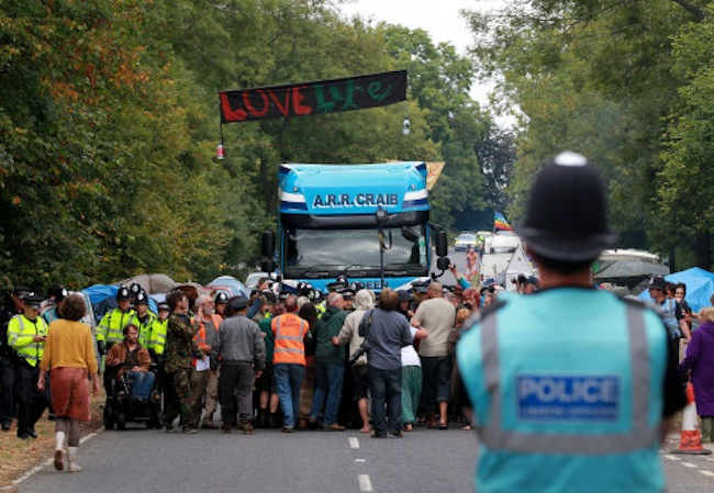 Environmental activists slow down a lorry heading to the Cuadrilla exploratory drilling site in Balcombe, West Sussex, as anti fracking demonstrations continue.