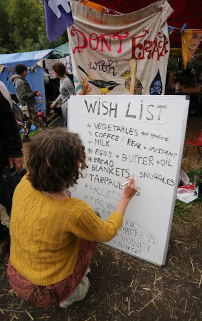 An environmental activist prepares a wish list of items needed for the camp outside the Cuadrilla exploratory drilling site in Balcombe, West Sussex, as anti fracking demonstrations continue.