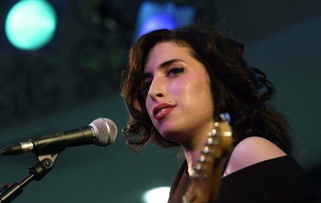 Singer Amy Winehouse during her performance at HMV Oxford Street, central London, where she celebrated the release of her new single Take The Box and signed autographs.