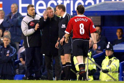 Manchester United's Manager Sir Alex Ferguson remostrates with referee P. Dowd as fourth official Mark Halsey moves to support his colleage.