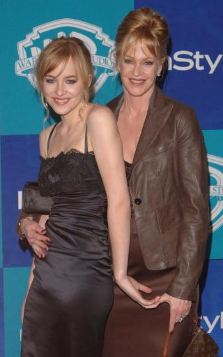 Melanie Griffith (right) and her daughter Dakota Johnson arrive at the In Style Magazine and Warner Bros. Studios post Golden Globes party at the Beverly Hilton Hotel, Los Angeles, USA Monday 16 January 2006. See PA Story SHOWBIZ Globes. PRESS ASSOCIATION Photo. Photo credit should read Ian West/PA.