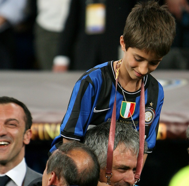 Inter Milan manager Jose Mourinho celebrates with his son after the final whistle