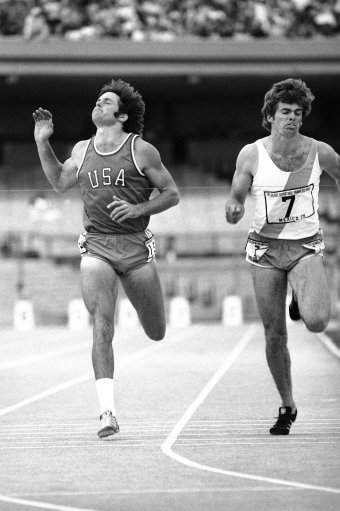 Bruce Jenner of San Jose Calif., stretches to win but comes in second to Argentina's Tito Steiner, right, in the 1,500 meter event of the men's decathlon at the Pan Am Games in Mexico City on Oct. 19, 1975. Jenner won the decathlon with a Pan Am Games record total of 8,045 points. Fred Dixon of Burhank, Calif., won the silver medal with 8,019 points. (AP Photo/Lennox McLendon)