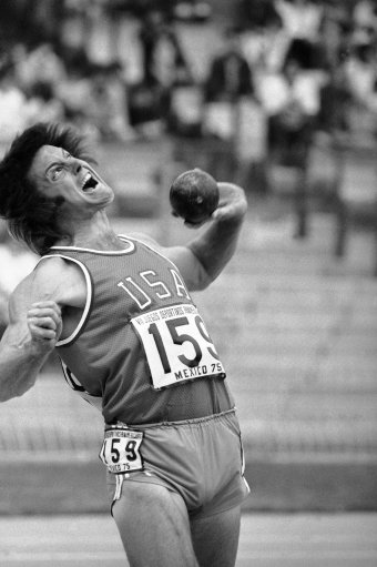 Bruce Jenner of San Jose, Calif., strains as he throws the shot put in the decathlon competition at the Pan Am Games in Mexico City on Saturday, Oct. 11, 1975. Competitors will partake in five events over the next two days. (AP Photo)