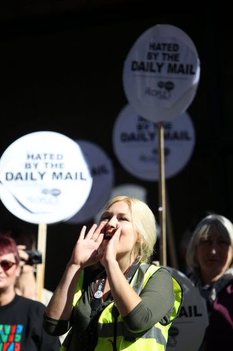 "Protesters gather outside the head office of the Daily Mail in west London, as the row continues over the Daily Mail article about opposition leader Ed Miliband's late father Ralph Miliband - a noted Marxist academic - under the headline: ""The man who hated Britain""."