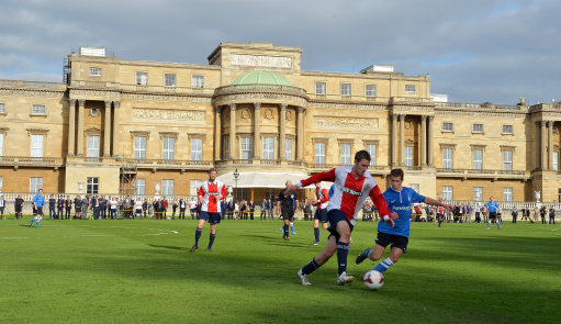 Polytechnic FC (in blue), during their match with the Civil Service FC in Buckingham Palace's garden, central London.