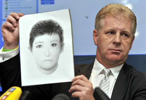 McCann Spokesperson Clarence Mitchell holding an e-fit of a Victoria Beckham lookalike who may have information about missing Madeleine McCann.