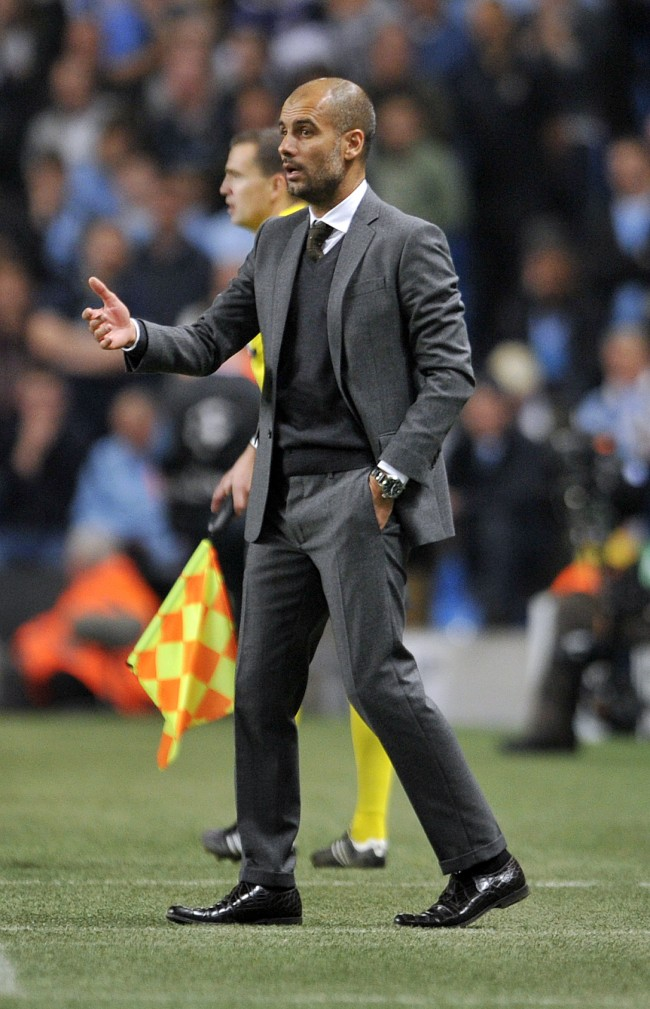PA 17799775 Manchester City beaten by a bemused teacher on a Hugo Boss fashion shoot