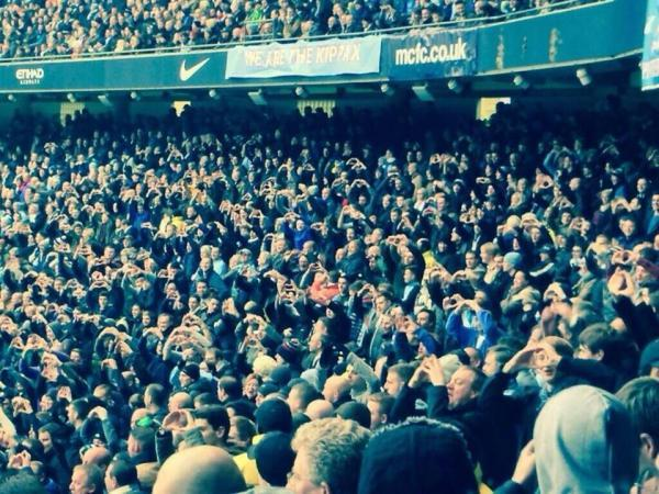 City fans doing the Gareth Bale heart to the Spurs end