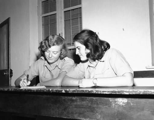 Two Jewish girls fill out their registration forms for the Jewish Army in Israel on Dec. 16, 1947. Many are now members of the semi-official Haganah.