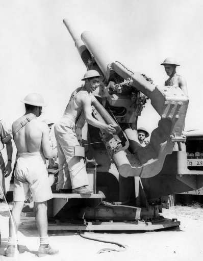 Palestine is very well protected against any air attack, and a visit was made to one of the Anti-Aircraft batteries, during a practice shoot. One of the gun crews in action on August 12, 1940. (AP Photo)