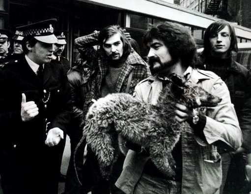 He holds a dead fox in his hands. But Dave Wetton of the NX Hunts Saboteurs Association is not allowed to stop to make a protest. The Police moved him on from outside The British Sports Society's Office in Caxton St.London. 2-12-1973