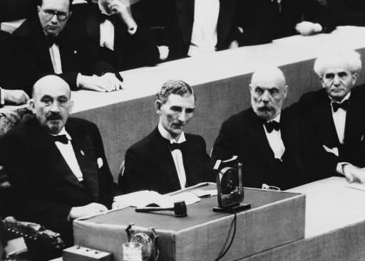 Dr. Chaim Weizmann, presiding over the 21st Zionist Congress in Geneva, mad an attack on Great Britain's White paper proposals for the solution of the Palestine problem in his opening speech on August 17. Opposition has been determined on. Congress opened August 16. From left to right are Dr. Weizmann, Mr. Tom Williams, M.P., Mr. Ussischkin, and Mr. Ben Gurion at the Zionist congress at Geneva on August 16, 1939. Behind Dr. Weizmann is the Rev. Perlsweig, leader of English Zionism. (AP Photo)