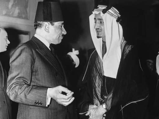 The Saudi-Arabian Princes Feisal and Khaled Ibn Seoud gave a Farewell Tea Party at Shepheard's Hotel, Cairo on April 27 to members of the diplomatic corps. They had been discussing Arab problems in Cairo. The Tea time walk was all about Palestine. Ali Maher Pash, Chief of the Egyptian Cabinet, with his host Prince Feisal, at the Cairo Tea Party on May 1, 1939. (AP Photo)