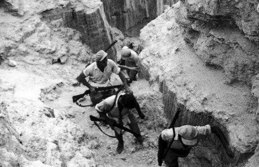 """The authorities are still making a determined bid to wipe out bands of rebels who are terrorizing Palestine. Volunteer """"terror squad"""" of police-helpers, armed with rifles, scouring the mountains of Samaria, central Palestine, in pursuit of rebels on Oct. 24, 1938."""