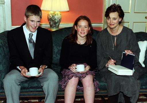 "The wife of British Prime Minister Tony Blair, Cherie Blair, (right) who hosted a tea part at No.10 Downing Street, for winners of the Motorola Youth Parliament Competition 2000.  * Cherie signs a book of their choice for, ""Best Speaker"" Felicity Galt from St Leonards School, St Andrews, for her debate on The abolition of fox hunting and ""Best Backbencher"" Paul Evans from St Michael's Roman Catholic Comprehensive School Billingham, for his debate : To re-nationalise the railways in the UK."