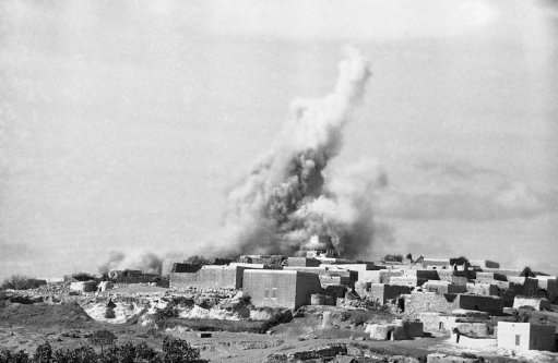 The British army dynamites Arab stone houses in northern Palestine in reprisal for rebel activities, Jan. 9, 1939.
